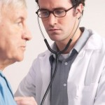 doctor-using-stethoscope-patient